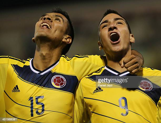 Cristian Arango of Colombia celebrates with teammate Sergio Villarreal after scoring during the football final match between Colombia and Ecuador as...
