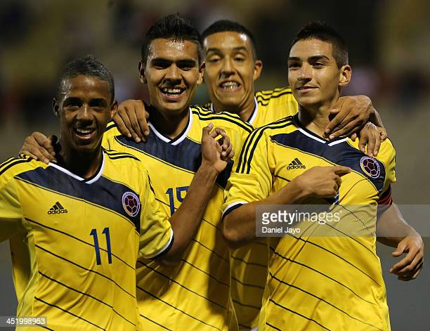 Cristian Arango of Colombia celebrates with teammates after scoring his third goal during the football final match between Colombia and Ecuador as...