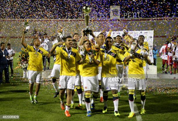 Cristian Arango of Colombia holds the trophy after winning the final match between Colombia and Ecuador as part of the XVII Bolivarian Games Trujillo...
