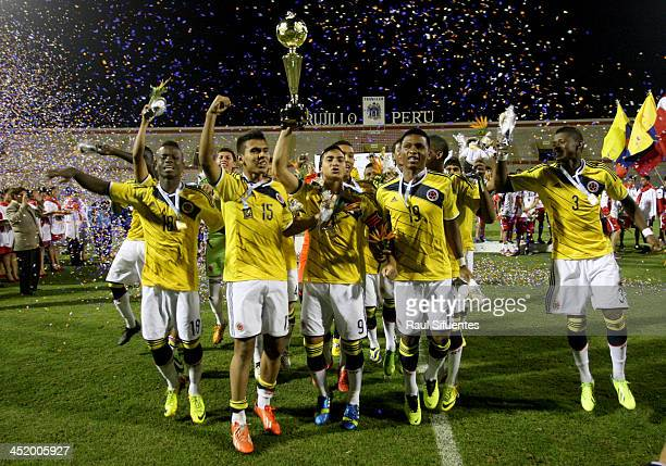 Cristian Arango of Colombia holds the trophy after wnning the final match between Colombia and Ecuador as part of the XVII Bolivarian Games Trujillo...