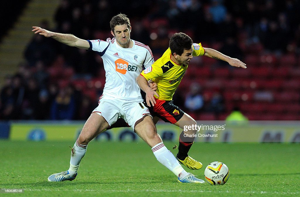 Cristian Battocchio of Watford is tackled by Bolton's <a gi-track='captionPersonalityLinkClicked' href=/galleries/search?phrase=Sam+Ricketts&family=editorial&specificpeople=609770 ng-click='$event.stopPropagation()'>Sam Ricketts</a> during the npower Championship match between Watford and Bolton Wanderers at Vicarage Road on February 02, 2013 in Watford England.