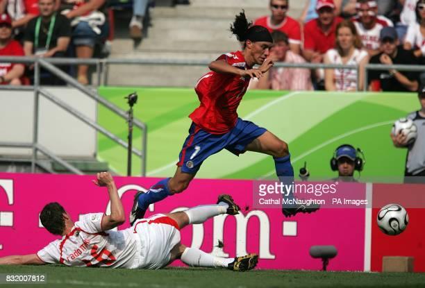 Cristian Bolanos Costa Rica skips over a challenge from Poland's Arkadiusz Radomski