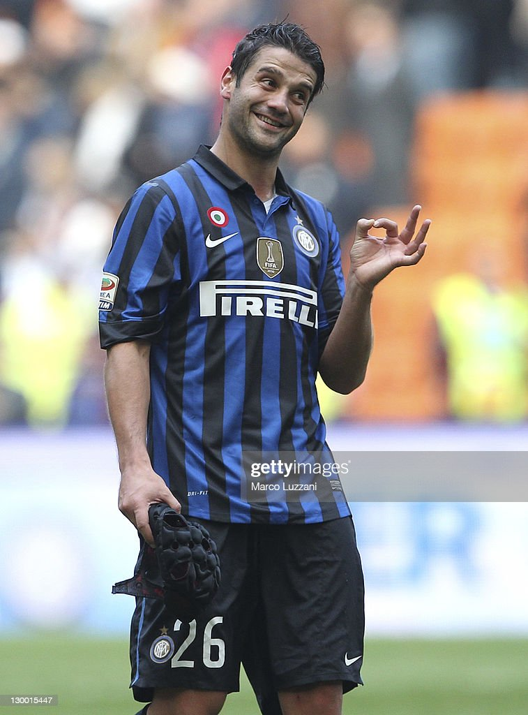 <a gi-track='captionPersonalityLinkClicked' href=/galleries/search?phrase=Cristian+Chivu&family=editorial&specificpeople=675968 ng-click='$event.stopPropagation()'>Cristian Chivu</a> of FC Internazionale Milano celebrates victory at the end of the Serie A match between FC Internazionale Milano and AC Chievo Verona at Stadio Giuseppe Meazza on October 23, 2011 in Milan, Italy.
