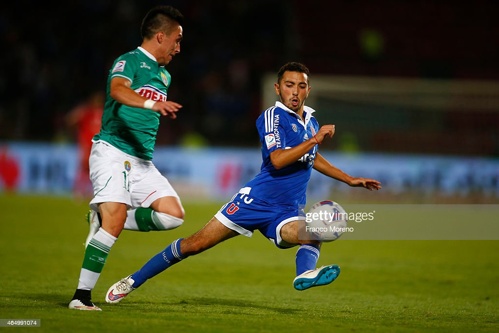 Cristian Cuevas of Universidad de Chile (R) fights for the ball with Bryan Carrasco of Audax Italiano (L) during a match between Universidad de Chile and Audax Italiano as part of round 9 of Torneo Scotiabank Clausura 2015 at Nacional Julio Martinez Pradanos Stadium on March 02, 2015 in Santiago, Chile.