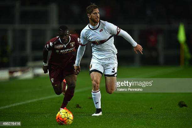 Cristian Daniel Ansaldi of Genoa CFC in action against Afriyie Acquah of Torino FC during the Serie A match between Torino FC and Genoa CFC at Stadio...