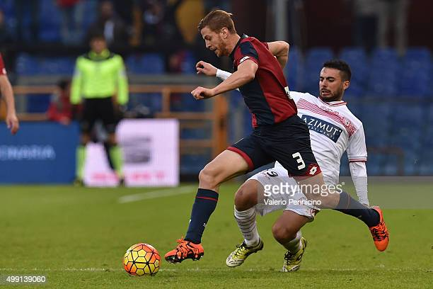 Cristian Daniel Ansaldi of Genoa CFC is challenged by Lorenzo Pasciuti of Carpi FC during the Serie A match between Genoa CFC and Carpi FC at Stadio...