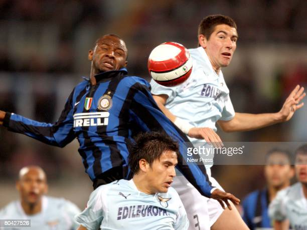 Cristian Daniel Ledesma and Aleksandar Kolarov of Lazio vie for the ball with Patrick Vieira of Inter during the Serie A match between Lazio and...