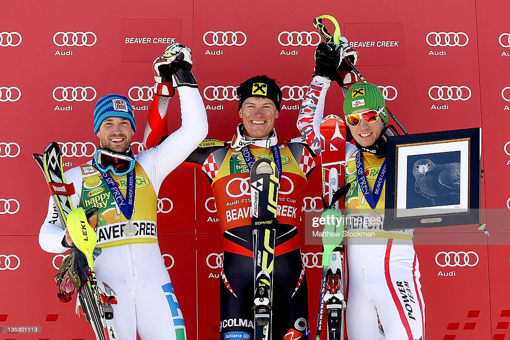 Cristian Deville of Italy Ivica Kostelic of Croatia and Marcel Hirscher of Austria celebrate on the victory podium after the men's slalom on the...