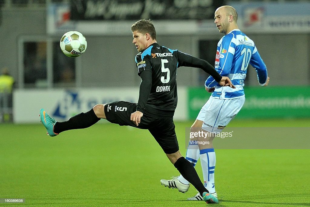 Cristian Dorda of Heracles Almelo, Arne Slot of PEC Zwolle during the Dutch Cup match between PEC Zwolle and Heracles Almelo at the IJsseldelta Stadium on january 30, 2013 in Zwolle, The Netherlands