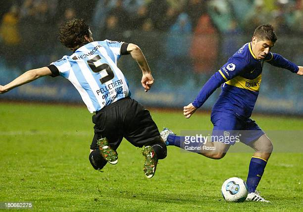 Cristian Erbes of Boca Juniors fights for the ball with Agustin Pelletieri of Racing Club during a match between Boca Juniors and Racing Club as part...