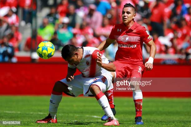 Cristian Erbes of Veracruz struggles for the ball with Efrain Velarde of Toluca during the 6th round match between Toluca and Veracruz as part of the...