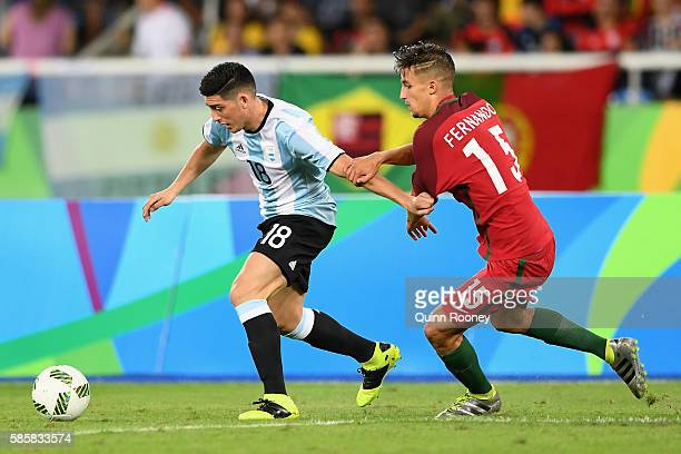 Cristian Espinoza of Argentina controls the ball under pressure during the Men's Group D first round match between Portugal and Argentina during the...