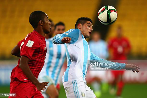 Cristian Espinoza of Argentina is challenged by Jesus Araya of Panama during the FIFA U20 World Cup New Zealand 2015 Group B match between Argentina...