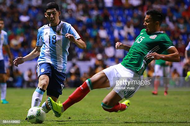 Cristian Espinoza of Argentina struggles for the ball with Carlos Salcedo of Mexico during an U23 International Friendly between Mexico and Argentina...