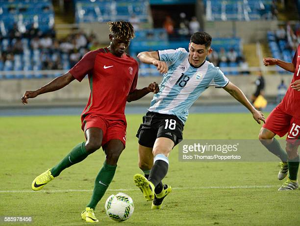 Cristian Espinoza of Argentina tackles Edgar Ie of Portugal during the Men's Group D first round match between Portugal and Argentina during the Rio...