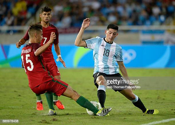 Cristian Espinoza of Argentina tackles Fernando of Portugal during the Men's Group D first round match between Portugal and Argentina during the Rio...