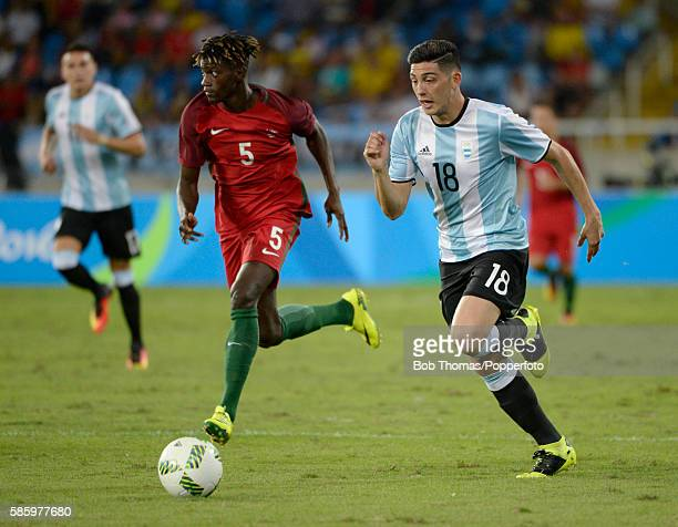 Cristian Espinoza of Argentina with Edgar Ie of Portugal during the Men's Group D first round match between Portugal and Argentina during the Rio...