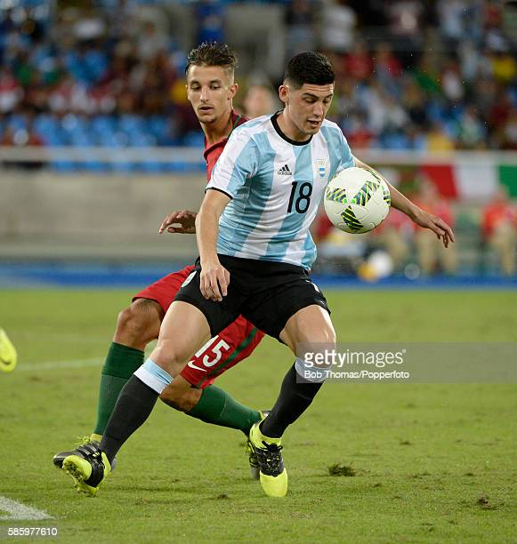 Cristian Espinoza of Argentina with Fernando of Portugal during the Men's Group D first round match between Portugal and Argentina during the Rio...