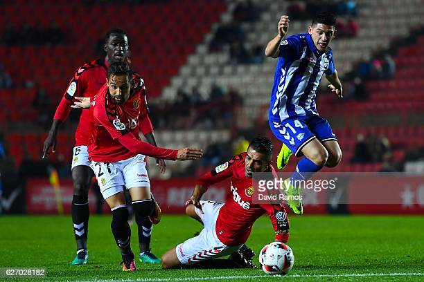 Cristian Espinoza of Deportivo Alaves competes for the ball with Nastic Tarragona players during the Copa del Rey round of 32 first leg match at Nou...