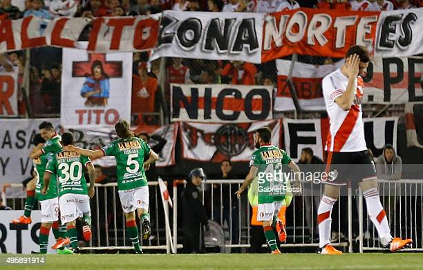 Cristian Espinoza of Huracan celebrates with teammates after scoring the opening goal during a first leg match between River Plate and Huracan as...