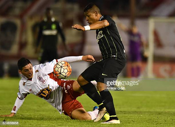 Cristian Espinoza of Huracan fights for the ball with Alexander Mejia of Atletico Nacional during a first leg match between Huracan and Atletico...