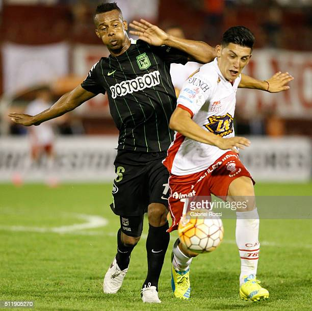 Cristian Espinoza of Huracan fights for the ball with Jonathan Copete of Atletico Nacional during a group stage match between Huracan and Atletico...
