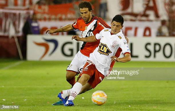 Cristian Espinoza of Huracan is fouled by Leonardo Ponzio of River Plate during a second leg match between Huracan and River Plate as part of Semi...