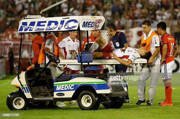 Cristian Espinoza of Huracan leaves the field injured during a second leg match between Huracan and River Plate as part of Semi Finals of Copa...