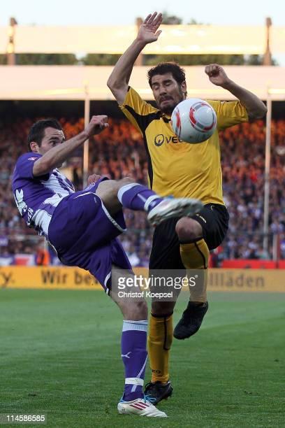 Cristian Fiél of Dresden challenges Kristoffer Andersen of Osnabrueck during the Second Bundesliga playoff second leg match between Dynamo Dresden...