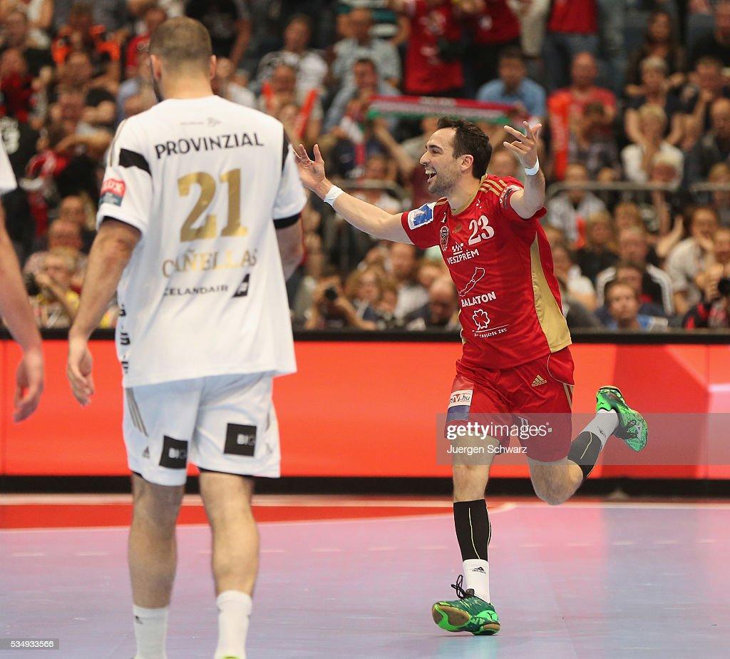 Cristian Garcia Ugalde of Veszprem (R) celebrates during the second semi-final of the EHF Final4 between THW Kiel and MVM Veszprem on May 28, 2016 in Cologne, Germany.