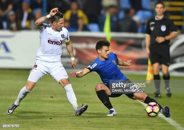 Cristian George Ganea of Viitorul Constanta and Ciprian Ioan Deac of CFR Cluj vie for the ball during the playoff match of the Romanian first league...
