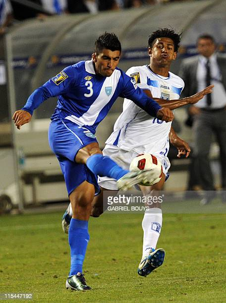Cristian Jafeth Noriega of Guatemala kicks the ball in font of Carlo Costly of Honduras during the 2011 CONCACAF Gold Cup first round match between...