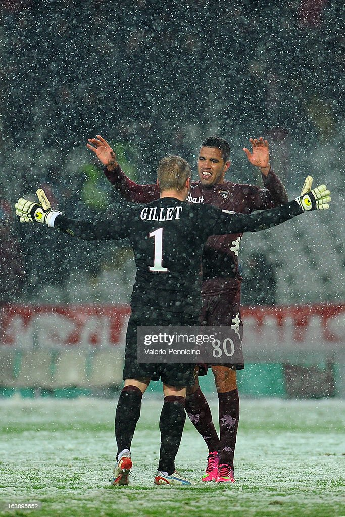 Cristian Jonathas (R) of Torino FC celebrate victory with his team mates Jean Francois Gillet at the end of the Serie A match between Torino FC and S.S. Lazio at Stadio Olimpico di Torino on March 17, 2013 in Turin, Italy.