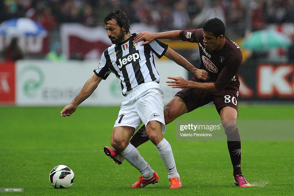 Cristian Jonathas (R) of Torino FC competes with Andrea Pirlo of Juventus during the Serie A match between Torino FC and Juventus at Stadio Olimpico di Torino on April 28, 2013 in Turin, Italy.