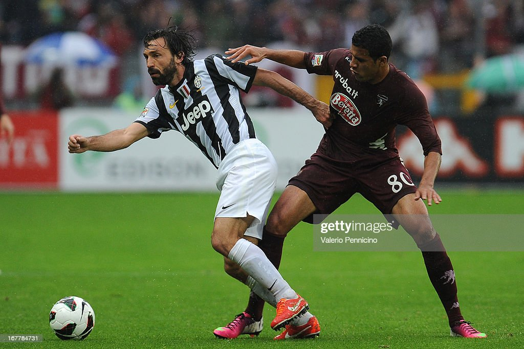 Cristian Jonathas (R) of Torino FC competes with <a gi-track='captionPersonalityLinkClicked' href=/galleries/search?phrase=Andrea+Pirlo&family=editorial&specificpeople=198835 ng-click='$event.stopPropagation()'>Andrea Pirlo</a> of Juventus during the Serie A match between Torino FC and Juventus at Stadio Olimpico di Torino on April 28, 2013 in Turin, Italy.