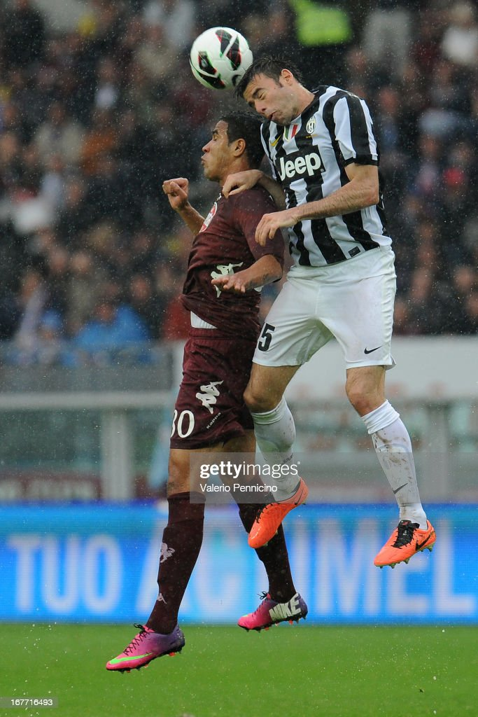 Cristian Jonathas (L) of Torino FC goes up with Andrea Barzagli of Juventus during the Serie A match between Torino FC and Juventus at Stadio Olimpico di Torino on April 28, 2013 in Turin, Italy.