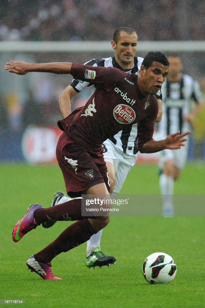Cristian Jonathas (L) of Torino FC in action against Giorgio Chiellini of Juventus during the Serie A match between Torino FC and Juventus at Stadio Olimpico di Torino on April 28, 2013 in Turin, Italy.