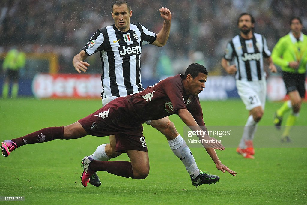 Cristian Jonathas (R) of Torino FC is tackled by <a gi-track='captionPersonalityLinkClicked' href=/galleries/search?phrase=Giorgio+Chiellini&family=editorial&specificpeople=605793 ng-click='$event.stopPropagation()'>Giorgio Chiellini</a> of Juventus during the Serie A match between Torino FC and Juventus at Stadio Olimpico di Torino on April 28, 2013 in Turin, Italy.