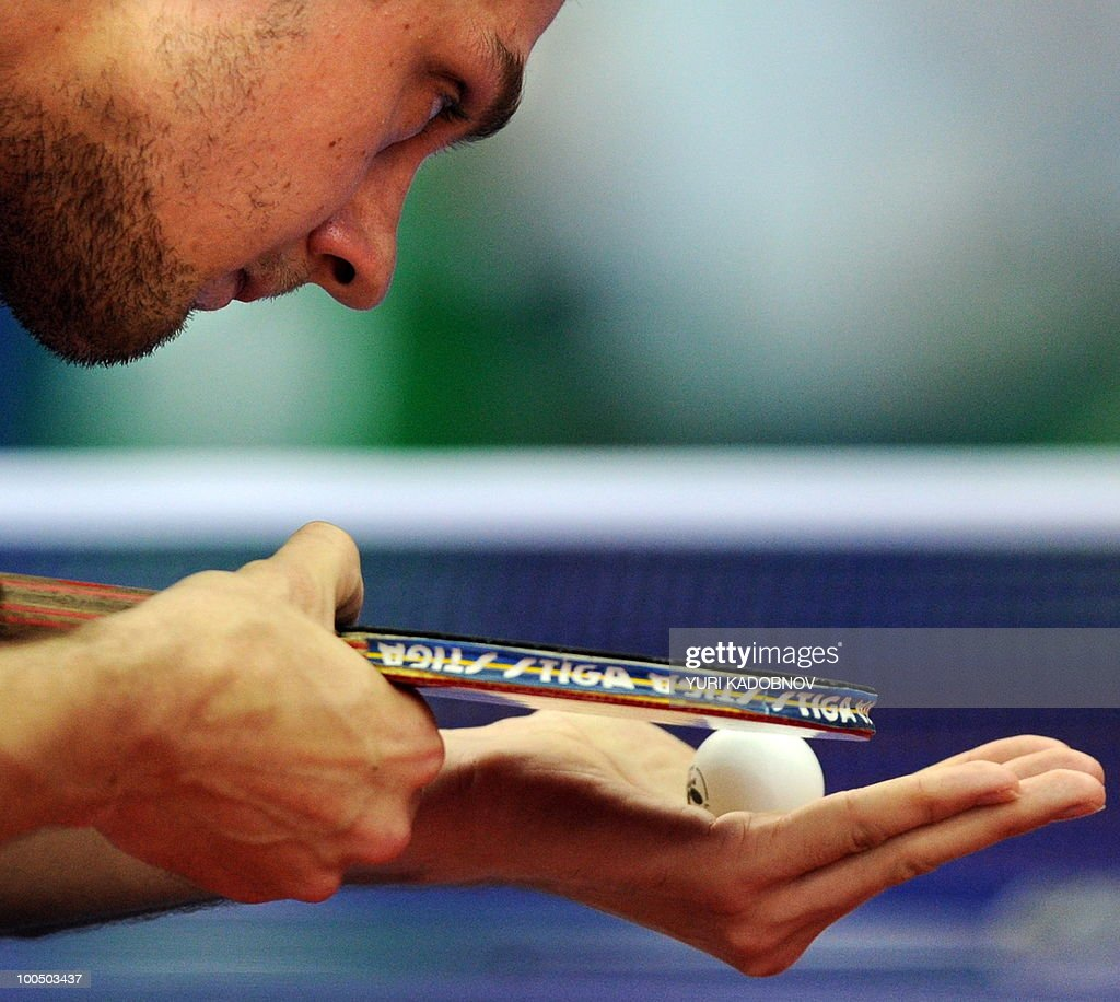 Cristian Kongsgaard of Denmark looks at a ball as he returns a service to Jun Mizutani of Japan during their men's teams group C match at the 2010 World Team Table Tennis Championships in Moscow on May 25, 2010.