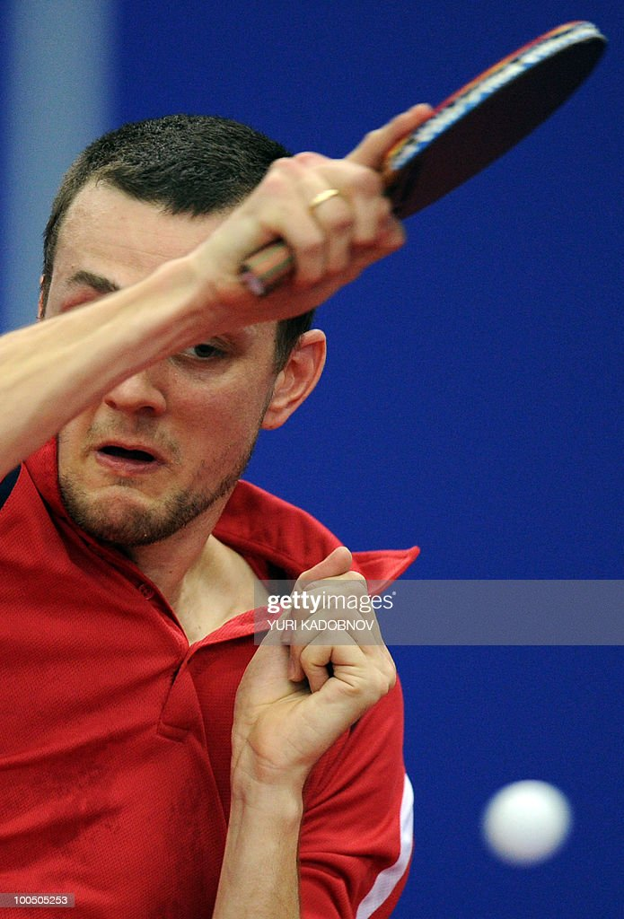 Cristian Kongsgaard of Denmark returns a service to Jun Mizutani of Japan during their men's teams group C match at the 2010 World Team Table Tennis Championships in Moscow on May 25, 2010.