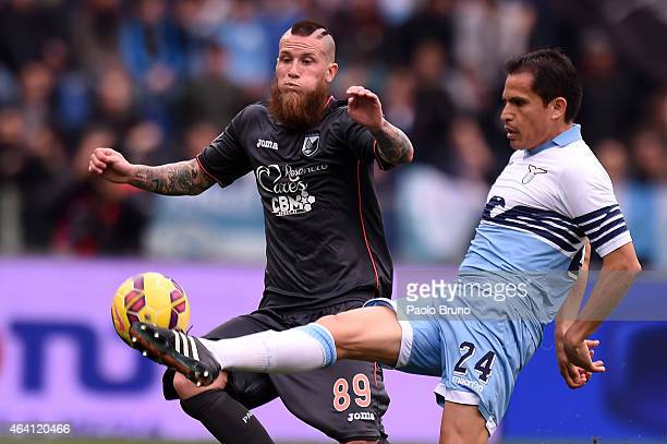 Cristian Ledesma of Lazio and Michel Morganella of Palermo compete for the ball during the Serie A match between SS Lazio and US Citta di Palermo at...