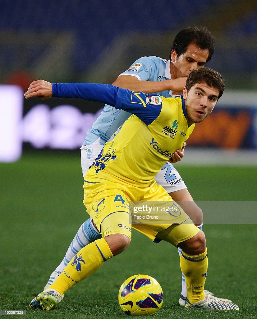 Cristian Ledesma (L) of S.S. Lazio competes for the ball with <a gi-track='captionPersonalityLinkClicked' href=/galleries/search?phrase=Alberto+Paloschi&family=editorial&specificpeople=3817495 ng-click='$event.stopPropagation()'>Alberto Paloschi</a> of AC Chievo Verona during the Serie A match between S.S. Lazio and AC Chievo Verona at Stadio Olimpico on January 26, 2013 in Rome, Italy.