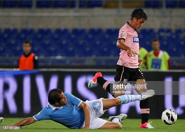 Cristian Ledesma of SS Lazio competes for the ball with Paulo Dybala of US Citta' di Palermo during the Serie A match between SS Lazio and US Citta...