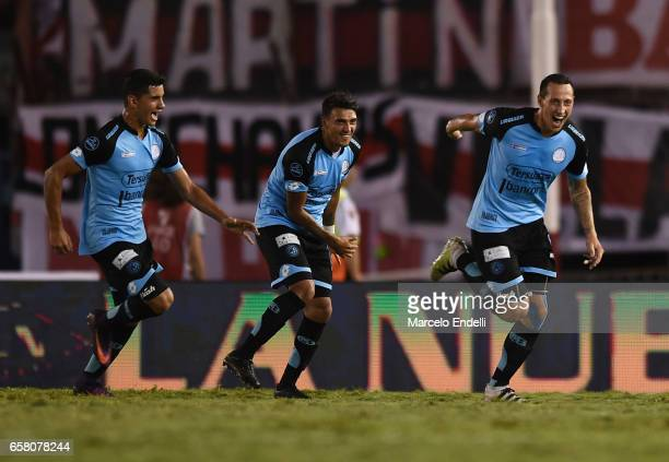 Cristian Lema of Belgrano celebrates with teammates after scoring the first goal of his team during a match between River Plate and Belgrano as part...