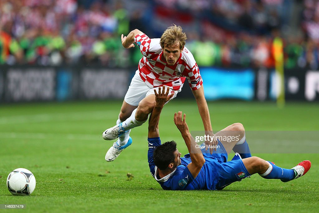 Cristian Maggio of Italy and Ivan Strinic of Croatia clash during the UEFA EURO 2012 group C match between Italy and Croatia at The Municipal Stadium on June 14, 2012 in Poznan, Poland.