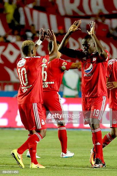 Cristian Martinez Borja of America de Cali celebrates with teammate Brayan Angulo after scoring the opening goal during a match between America de...