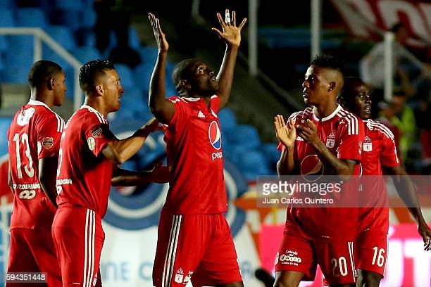 Cristian Martinez Borja of America de Cali celebrates with teammates after scoring the opening goal during a match between America de Cali and...