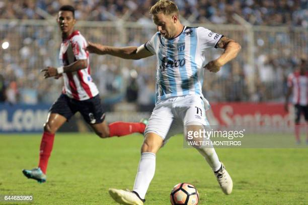 Cristian Menendez of Argentina's Atletico Tucuman vies for the ball with Jorge Aguirre of Colombia's Junior of Barranquilla during their Copa...