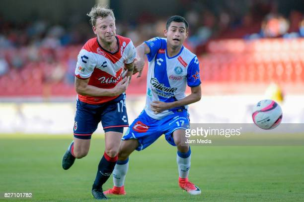 Cristian Menendez of Veracruz and Alonso Zamora of Puebla fight for the ball during the 3rd round match between Veracruz and Puebla as part of the...