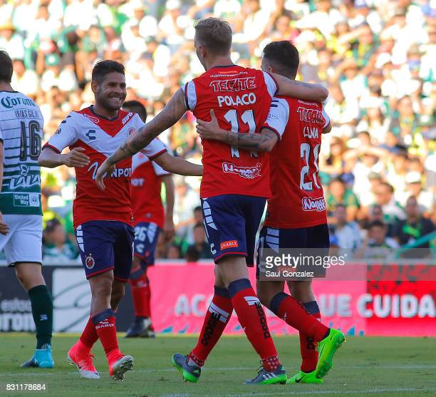 Cristian Menendez of Veracruz celebrates with teammates after scoring the first goal of his team during the 4th round match between Santos Laguna and...